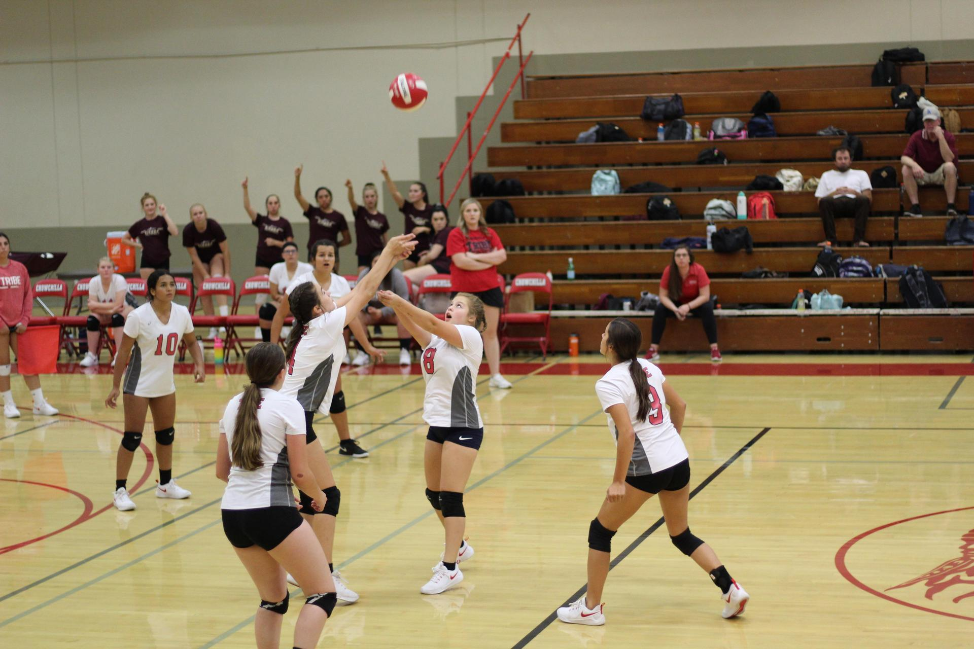 Junior Varsity girls playing volleyball against Sierra