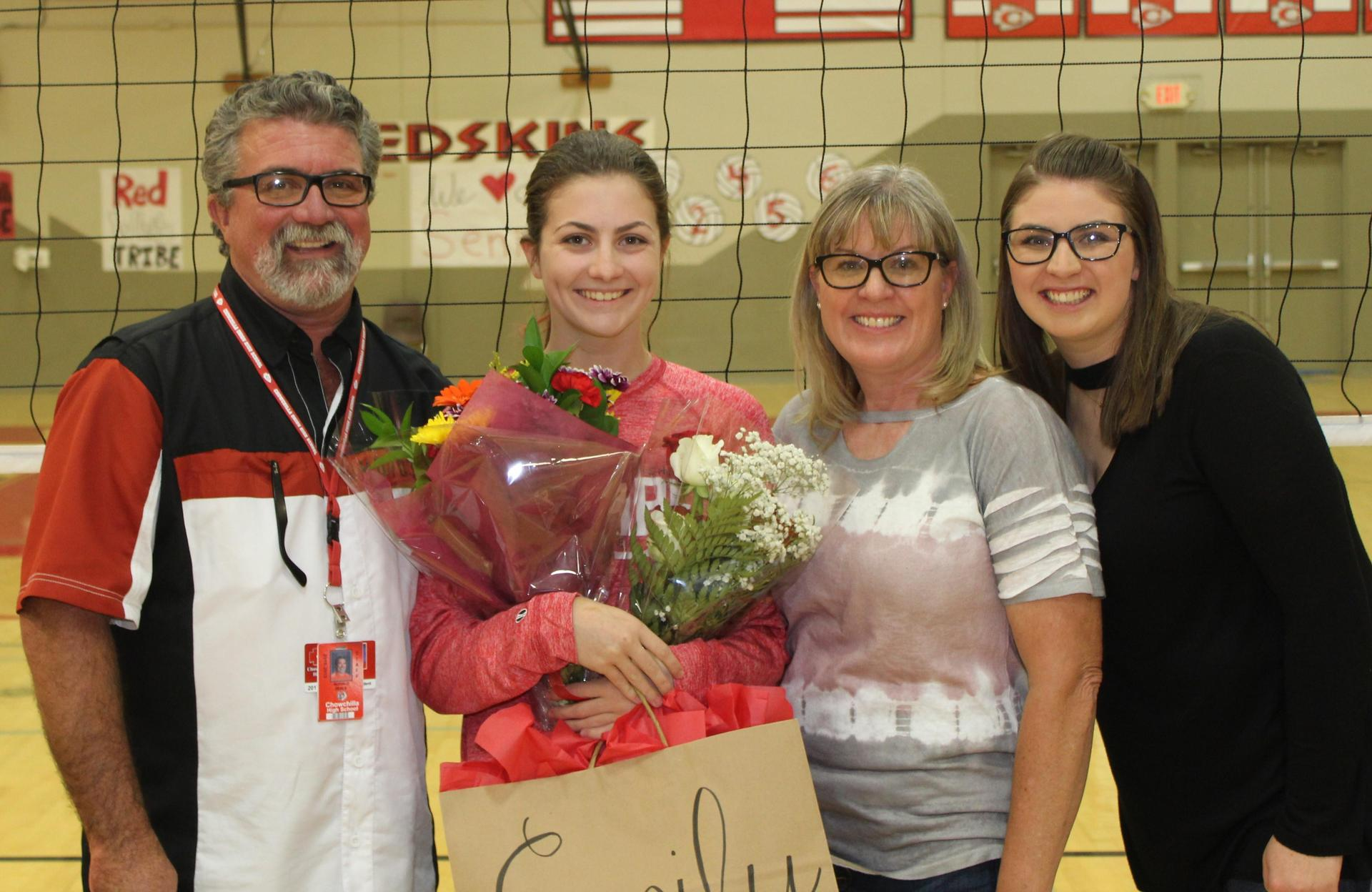 Emily Seals and Coach Shelby Seals with their parents on Volleyball Senior Night.