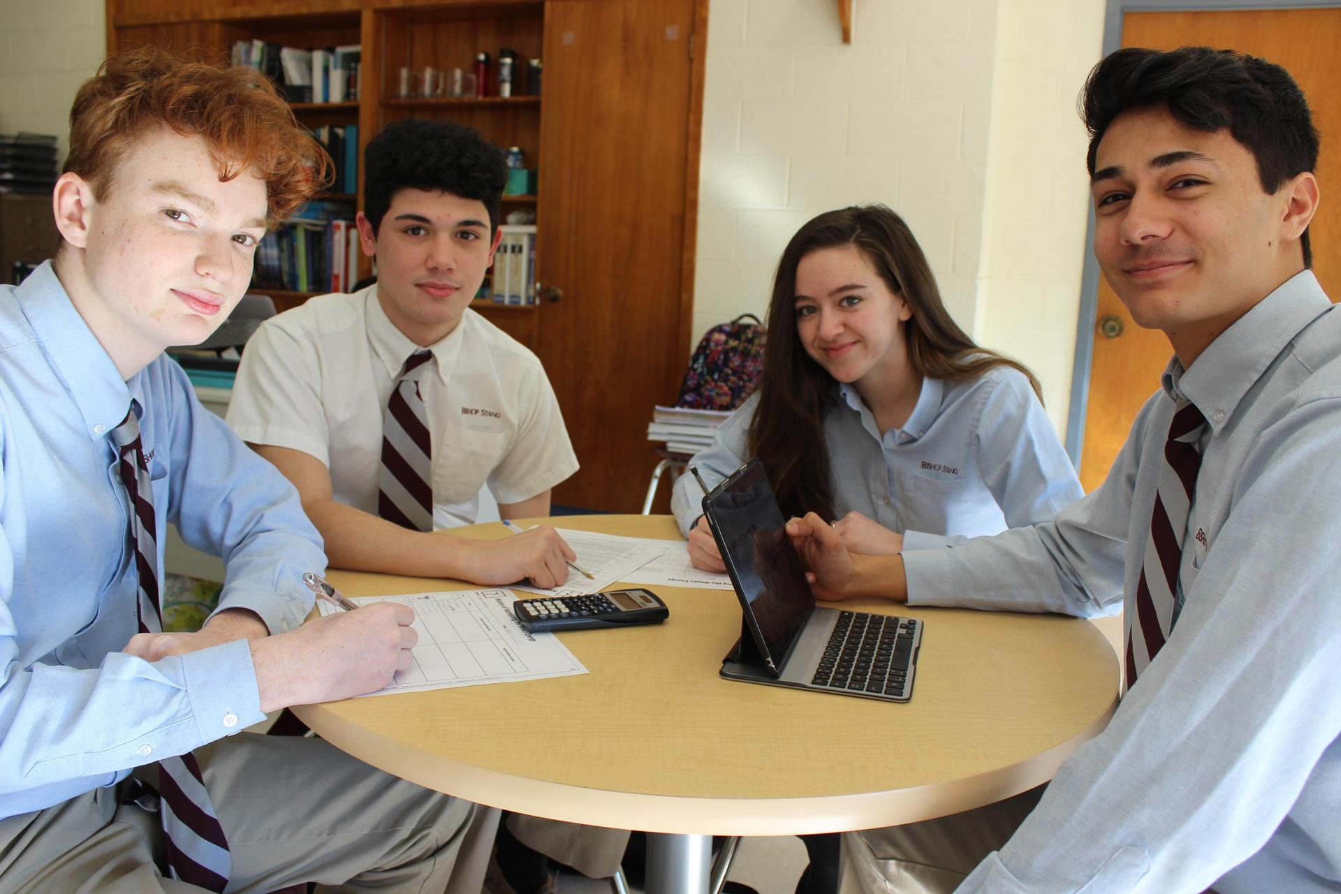 student studying together at a table
