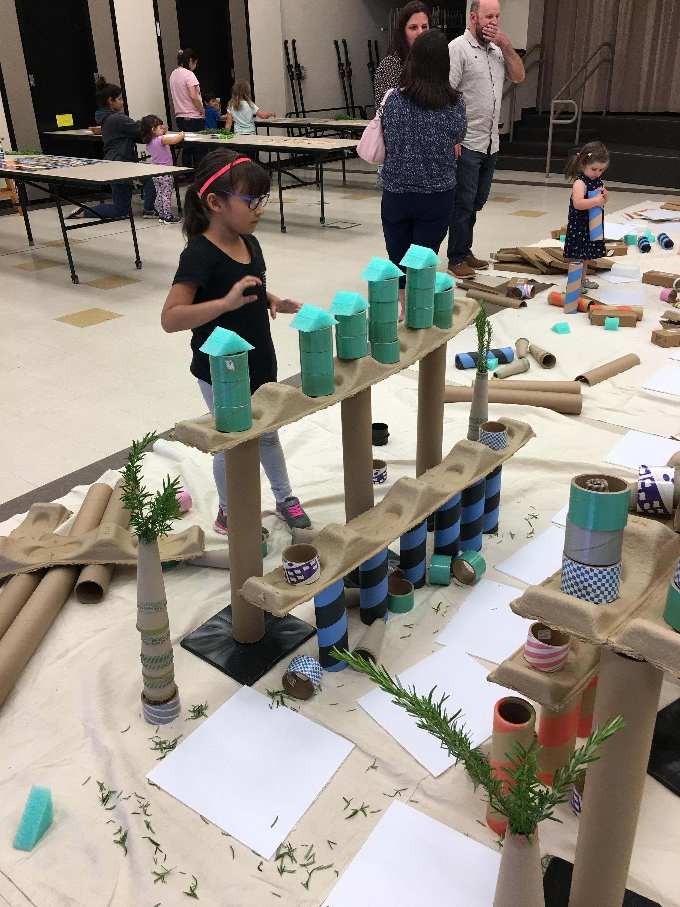 children building bridges with cardboard and blocks