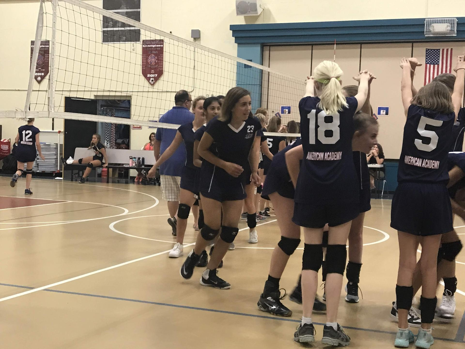Girls volleyball playing on the court.