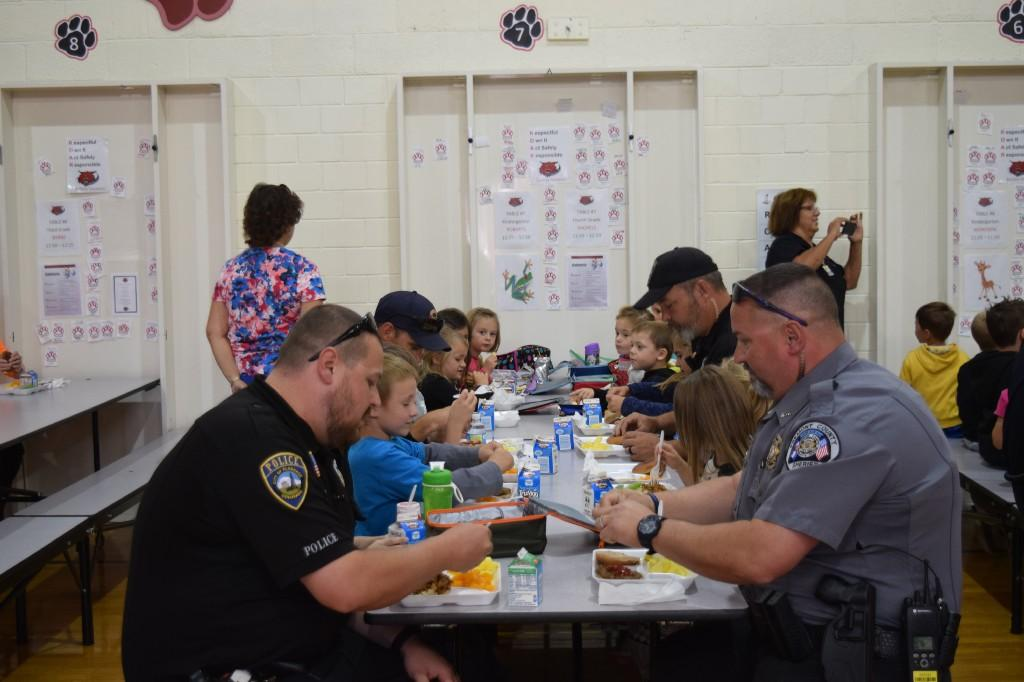Law Enforcement eating with students