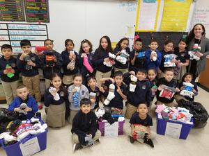 mrs. martinez class with the 1,103 socks collected