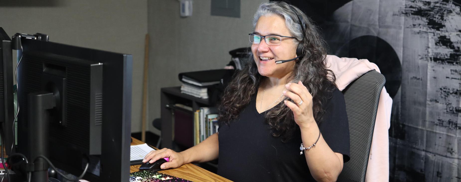 Teacher smiling while teaching online