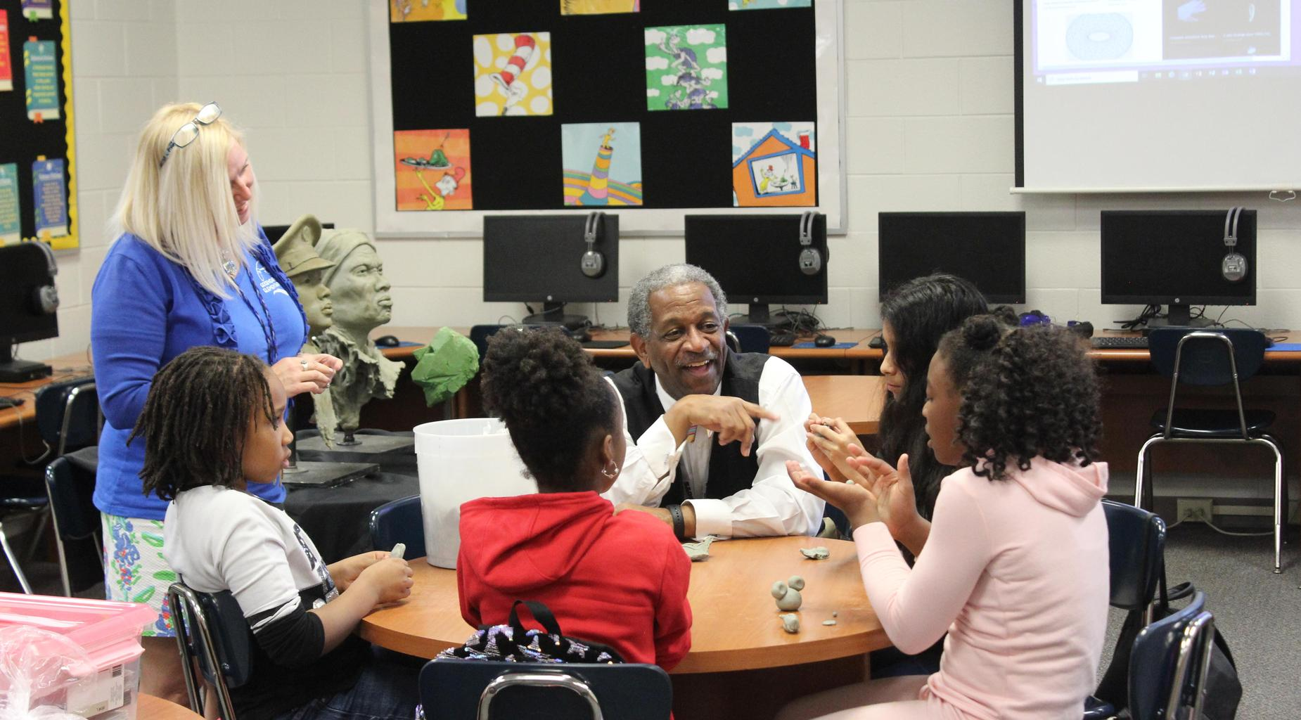 Kevin Pullen teaches students a sculpting lesson.