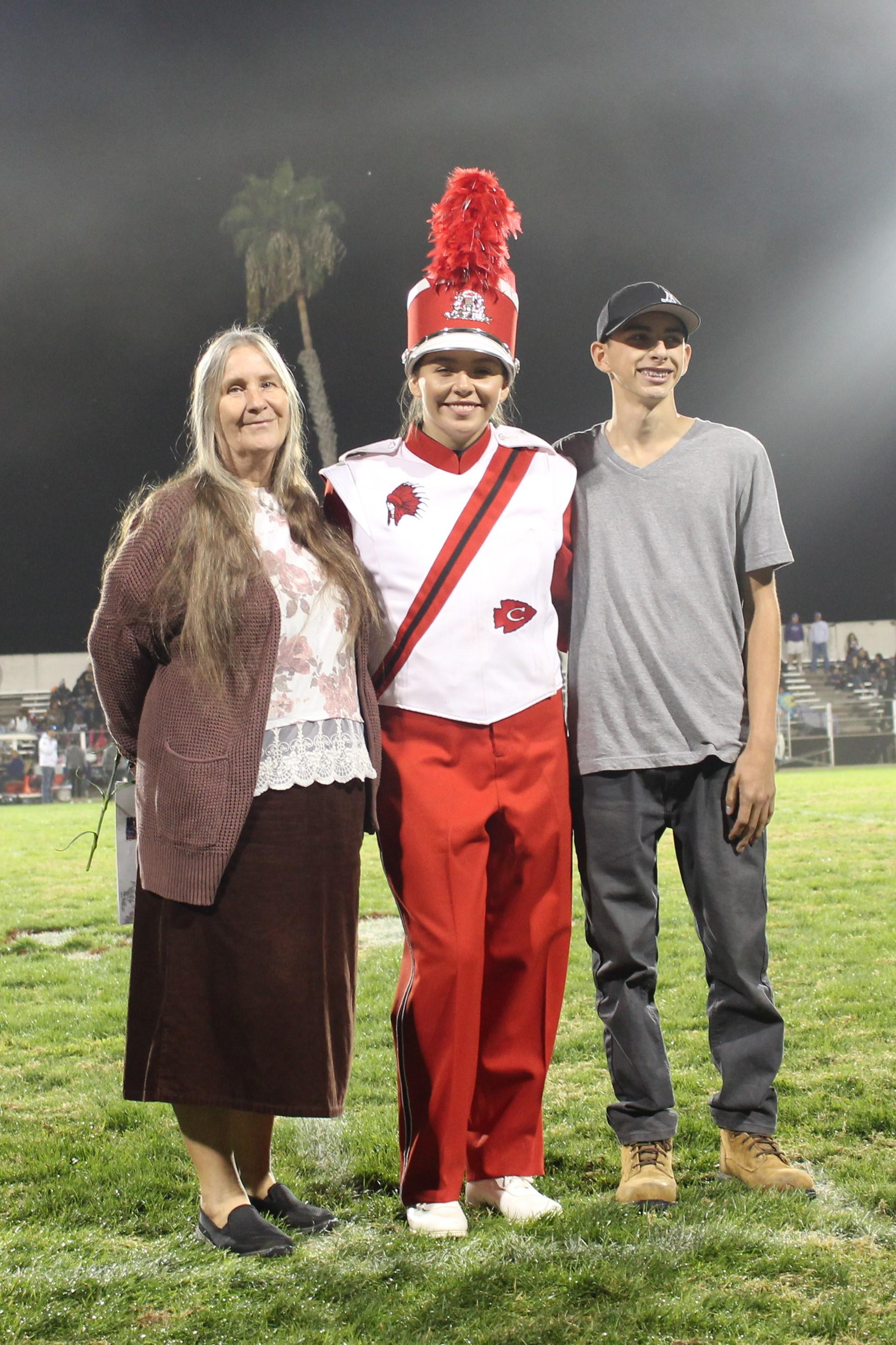 Senior band member Mikayla Mendoza and her escorts.