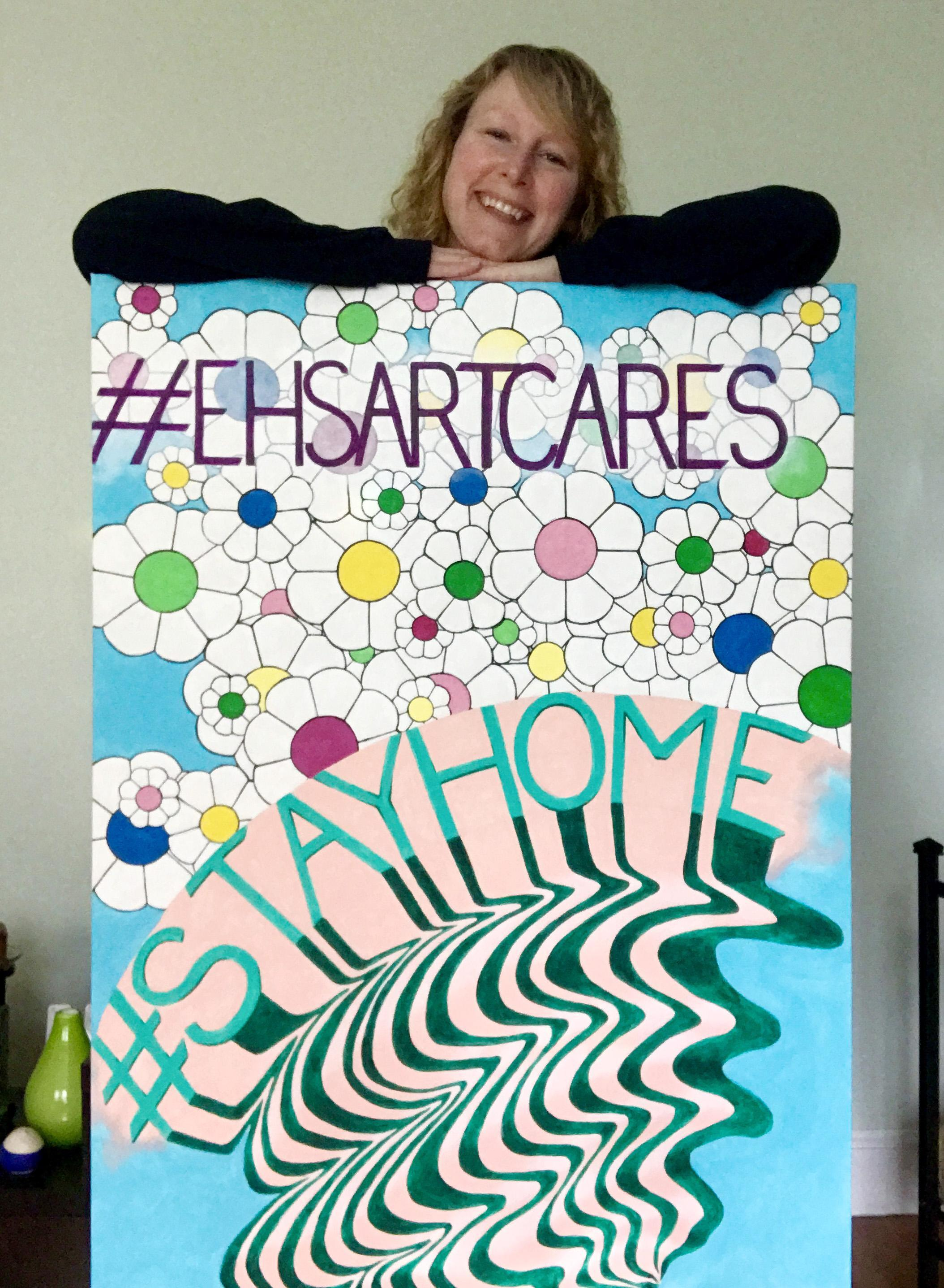 A large poster with flowers and the words 'Everett arts cares' in a wavy design