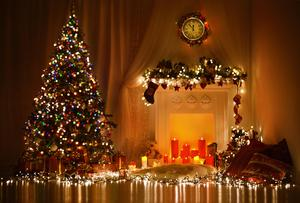 A picture of a Christmas tree and fireplace