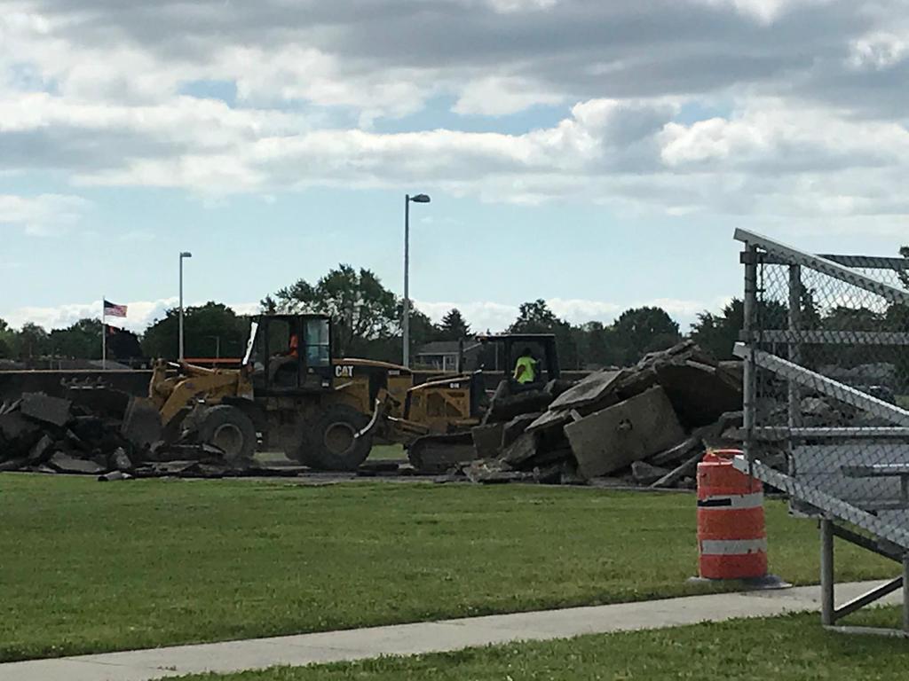 bulldozers cracking concrete
