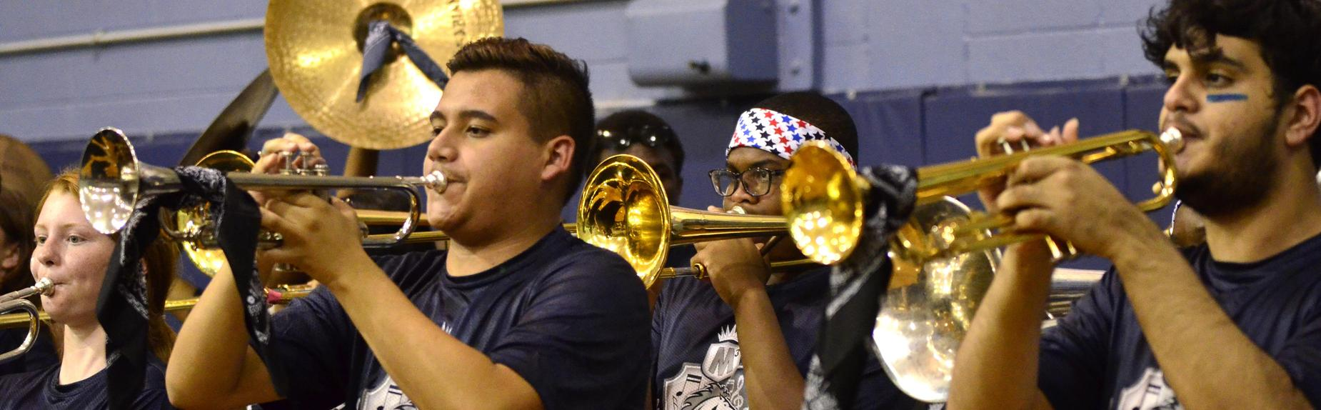 The Mustang Band performs at a pep rally.