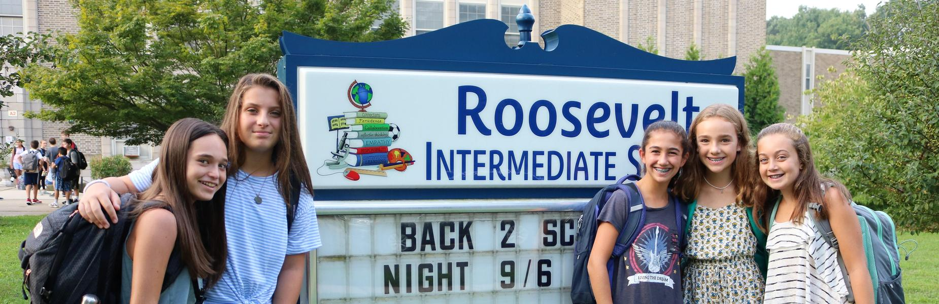 Roosevelt Intermediate School students pose in front school sign during the first week of the new school year.