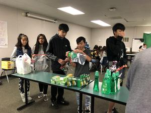 CCA students working on a toiletry assembly line.