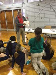 Mr.Roy Harris is reading to the students at Lake Arthur Elementary's Science Day.