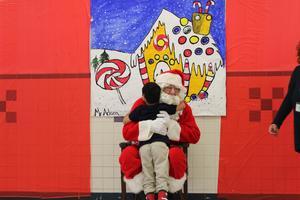 santa hugging a young boy