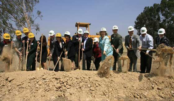photo of district dignitaries breaking ground for the new school