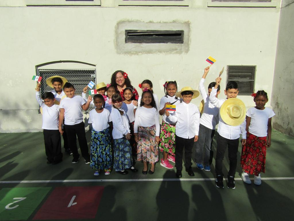 Mrs. Ramirez and her class dressed in their heritage costumes