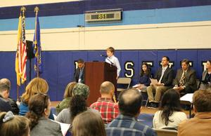 Roosevelt 7th grader Beckett Calder gives a brief history of Veterans Day at the school's annual assembly.