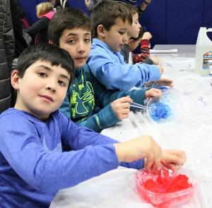 Two McKinley students enjoy learning the science of slime at the school's 6th Annual STEAM Night on Jan. 24.