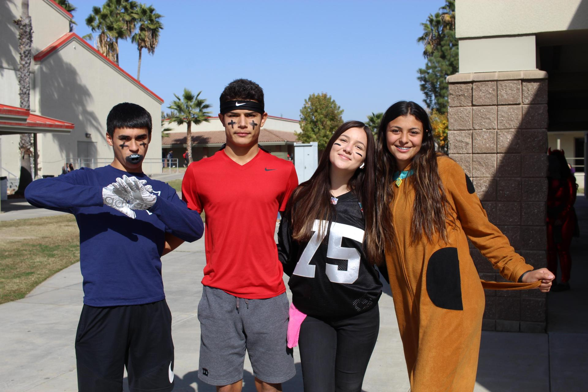 Emanuel Ochoa, Isaac Robles, Emily Valenzuela as football players with Kim Benavides as Scooby Doo