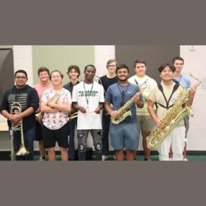 group of teen boys holding their brass horns
