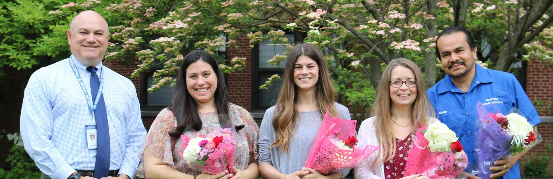 Photo of:  :  (From left) Westfield High School interim principal James DeSarno congratulates special education teacher Lara Rinaldi, English/Project '79 teacher Erin McKeon, English teacher Aimee Burgoyne-Black, and custodian Mario Arana who are this year's recipients of excellence awards for going above and beyond their responsibilities each day.   The four will be recognized by the Westfield Board of Education on Tuesday, June 11 at 7 p.m. at 302 Elm Street.
