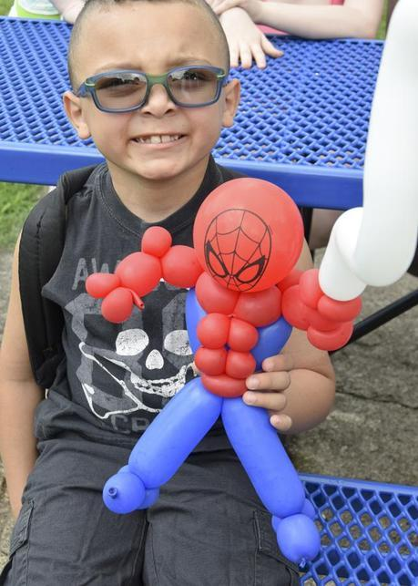 Camper with his balloon SpiderMan