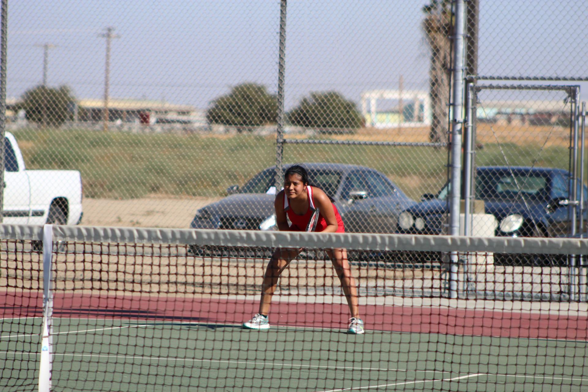 Girls playing tennis vs Liberty