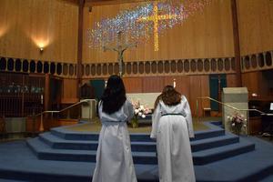 students at church altar