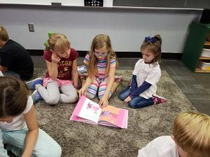 4th grade buddy reading with Kinders