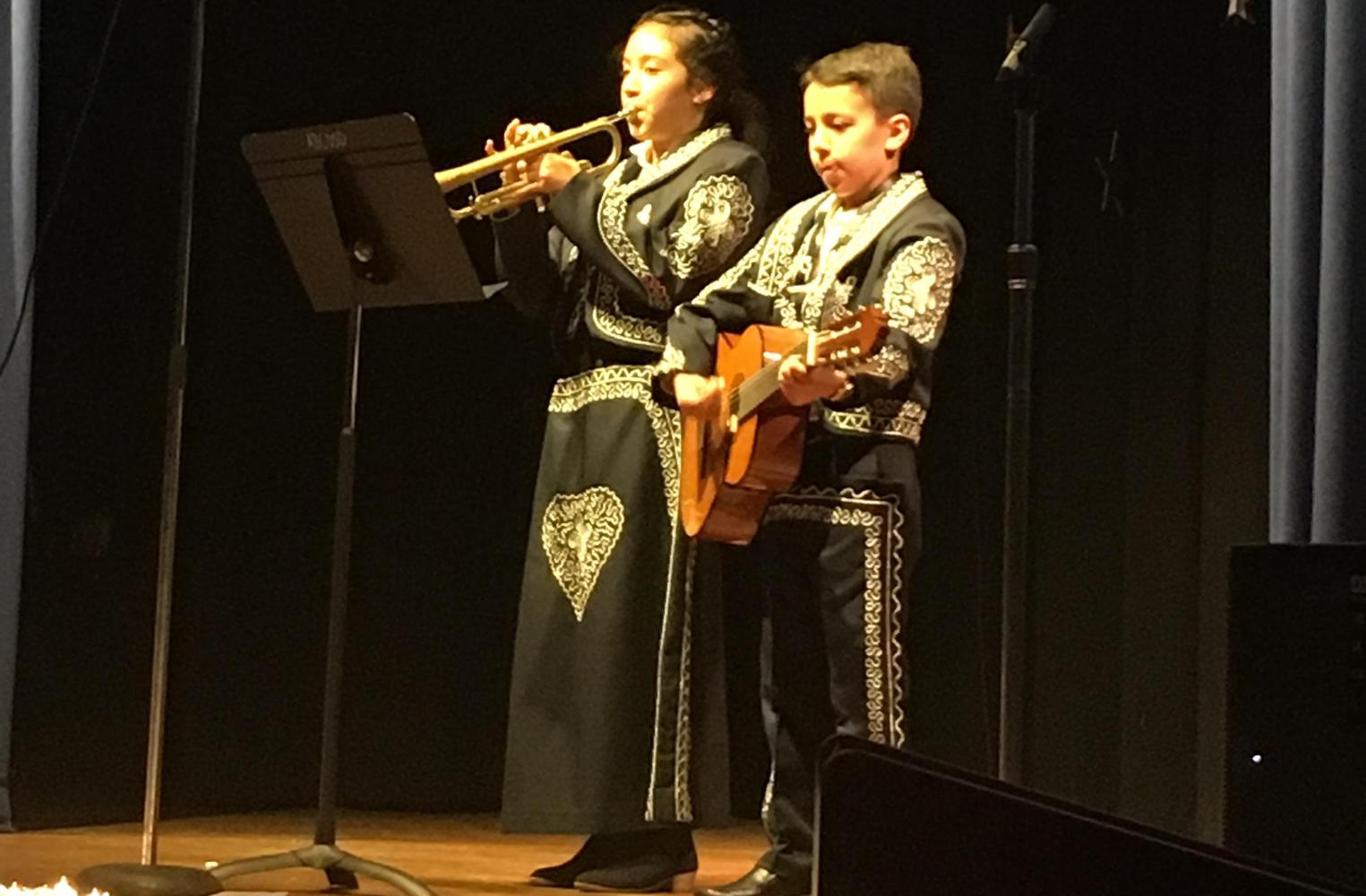 students performing mariachi music