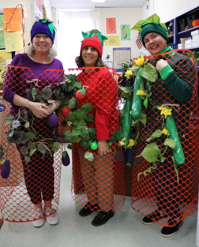 Three McKinley staffers dress as a vegetable garden on Halloween.