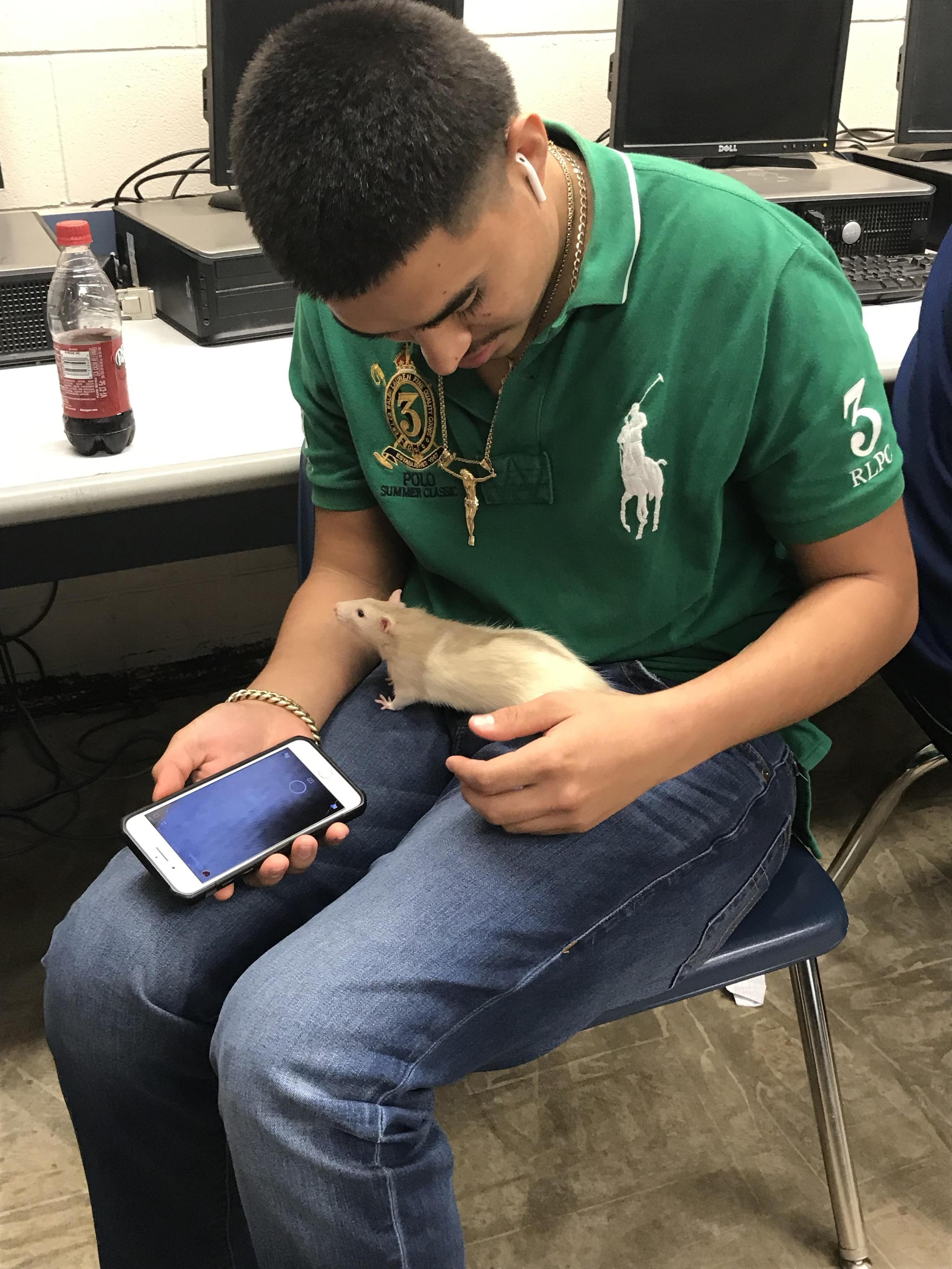 Student with class pet