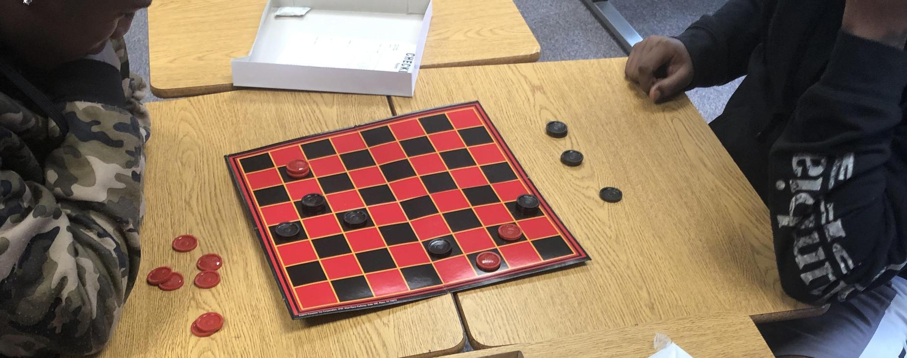 Students playing Checkers!