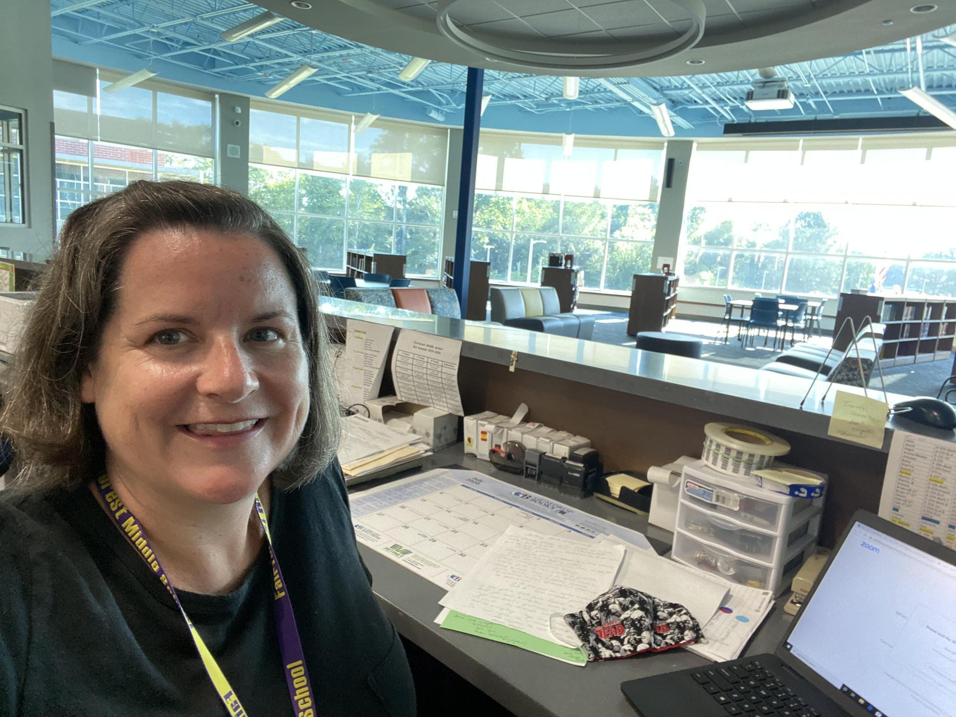Mrs. Scott a librarian's desk