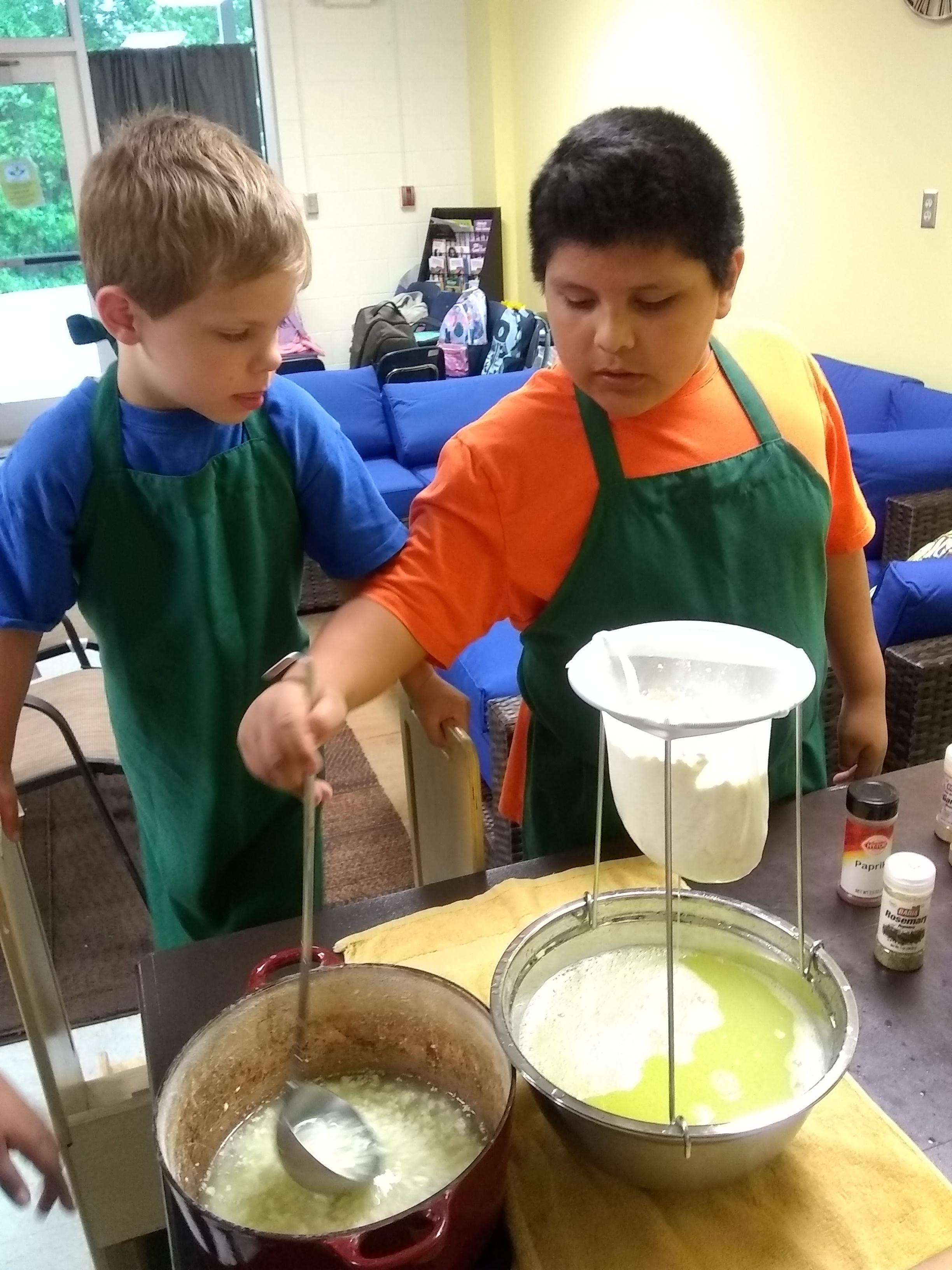 students straining curds