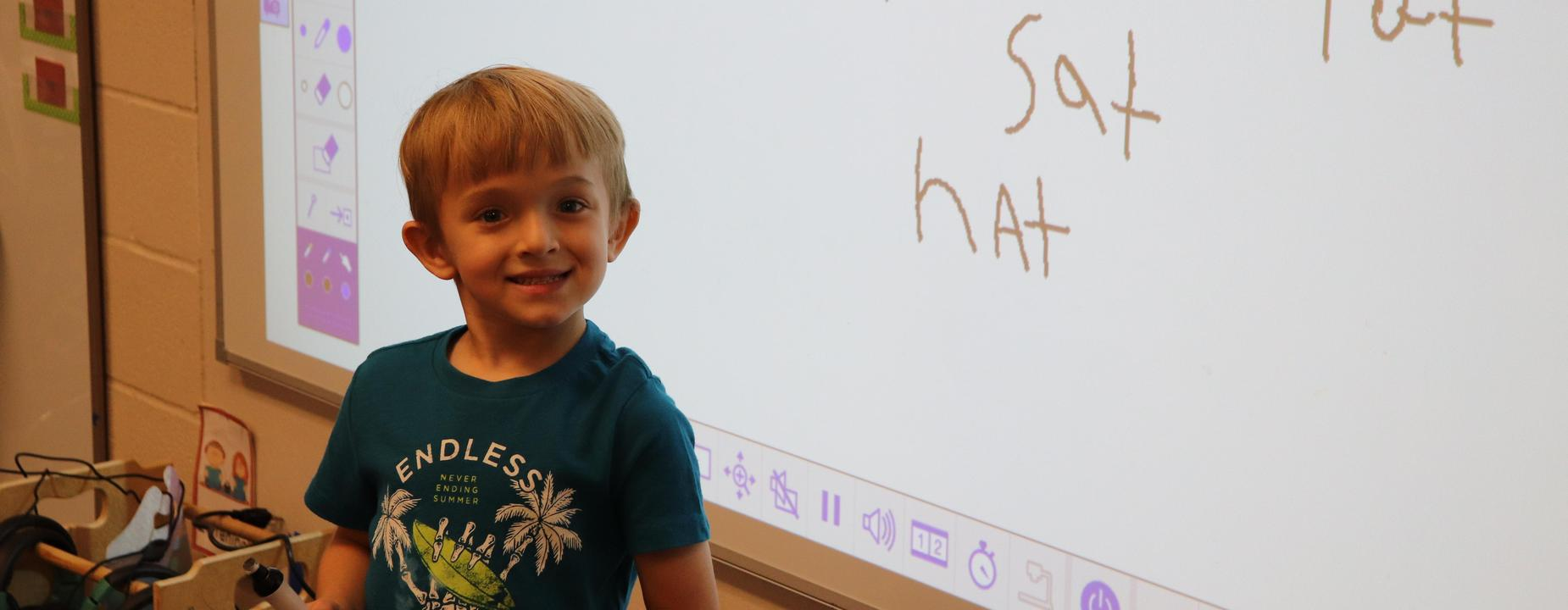 Primary Boy writing on board