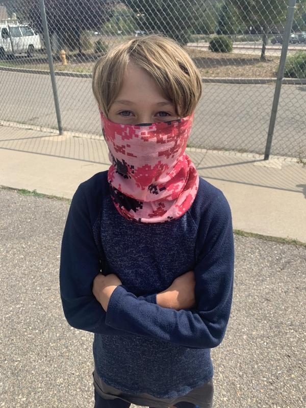 Student with mask on, on playground
