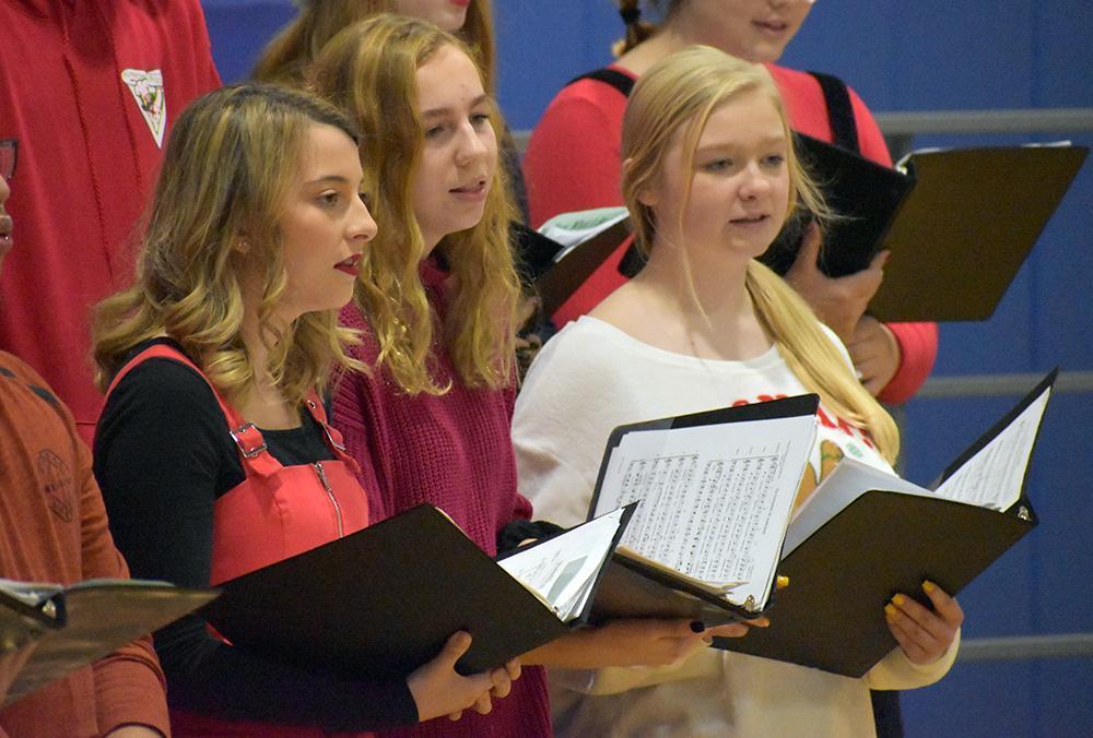 Chorus members sing