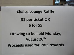 Sign for directions for raffle tickets for chaise lounge, 1 for $1, 6 for $5.