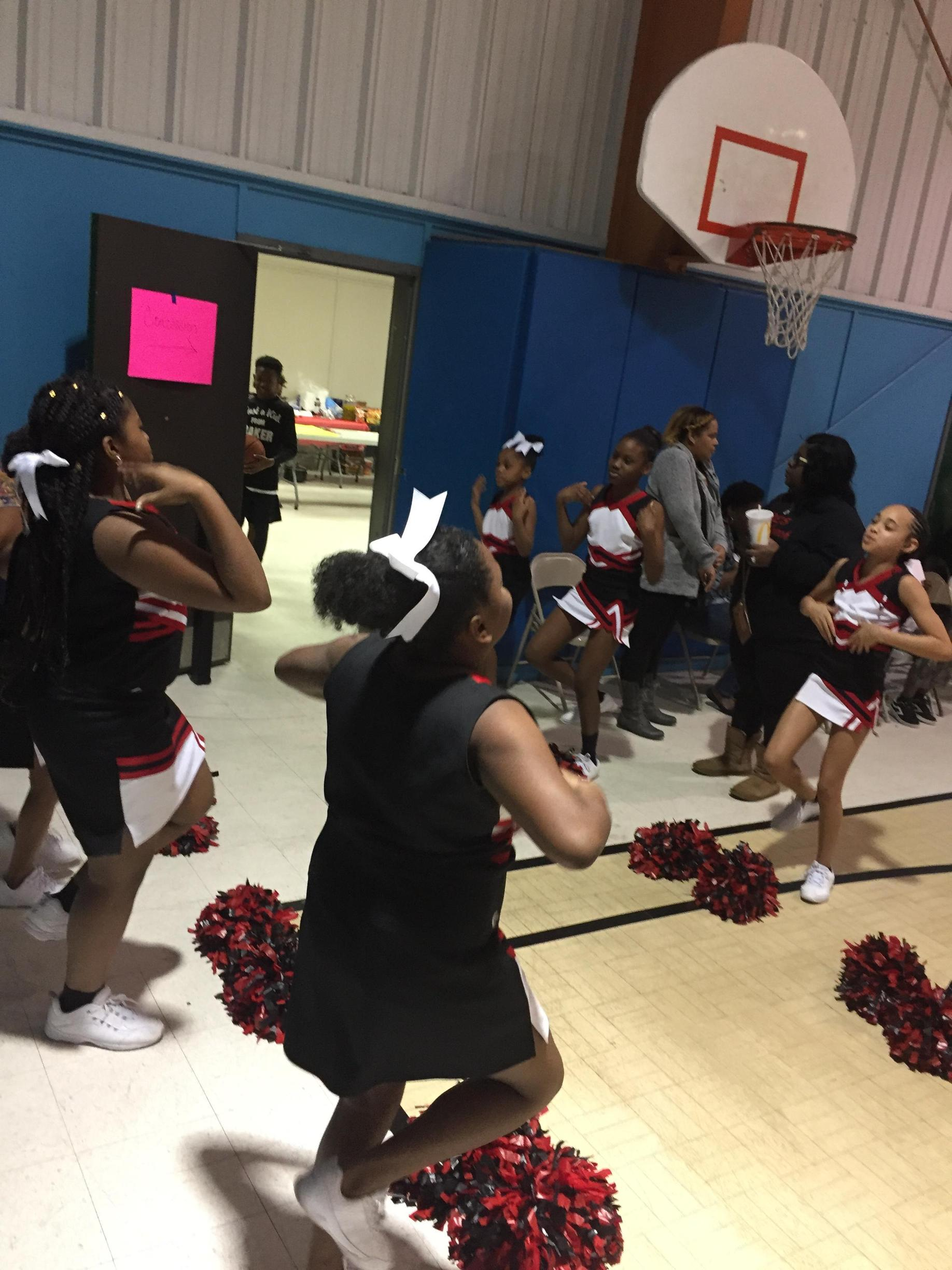 A photo of Bakerfield & Baker Heights Basketball Team In Action with Cheerleaders