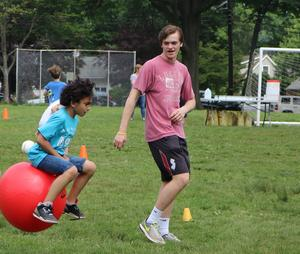 Student at Washington School enjoys hoppity-hop races during Field Day.