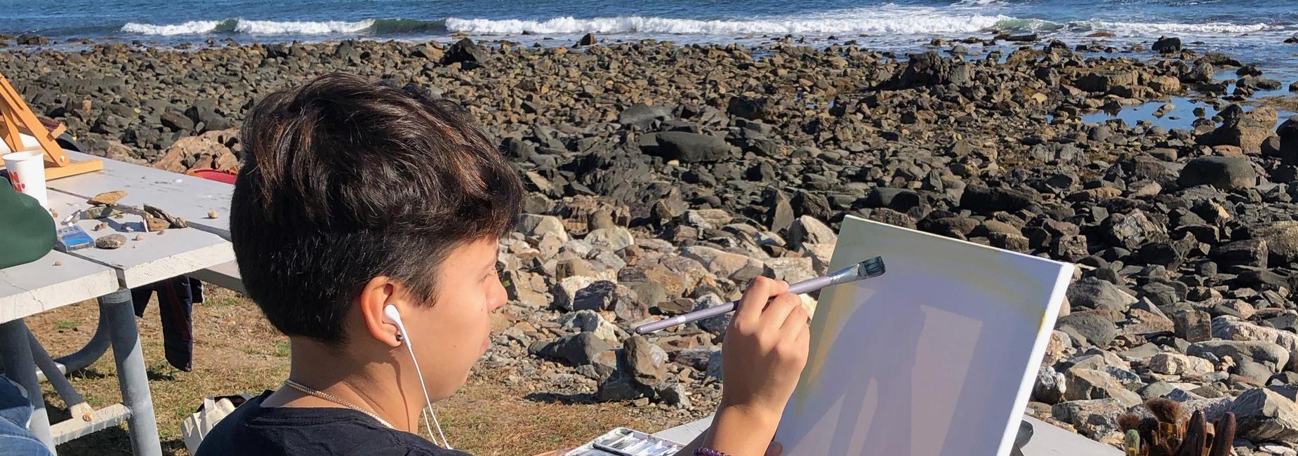 Student Painting At Beach