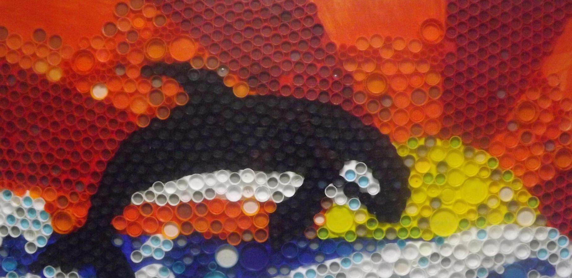 Whale art created from bottle caps