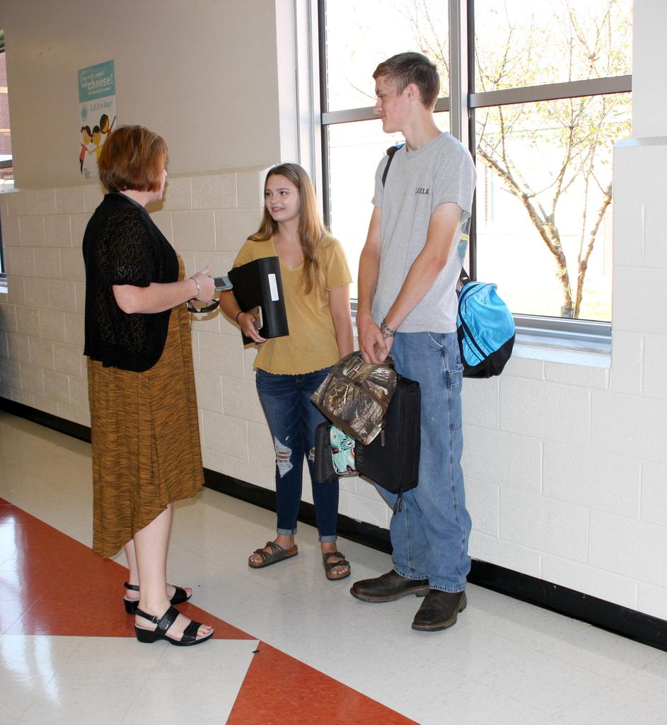 Principal talks to students on the first day of school at West Wilkes High School.