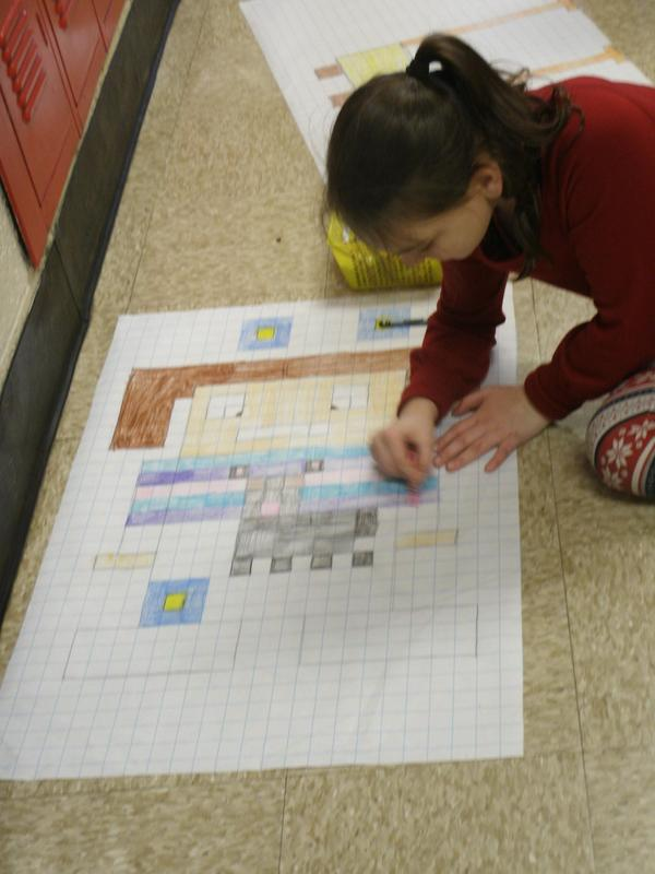 Third graders use robots and graph paper to study area.