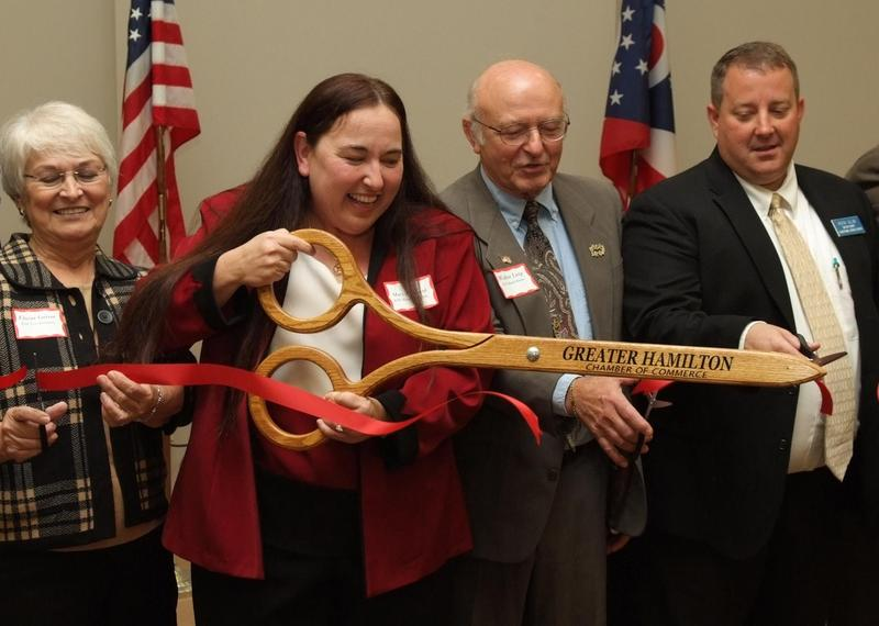 Mary Pritchard cuts the ribbon on the Butler County ESC central office.