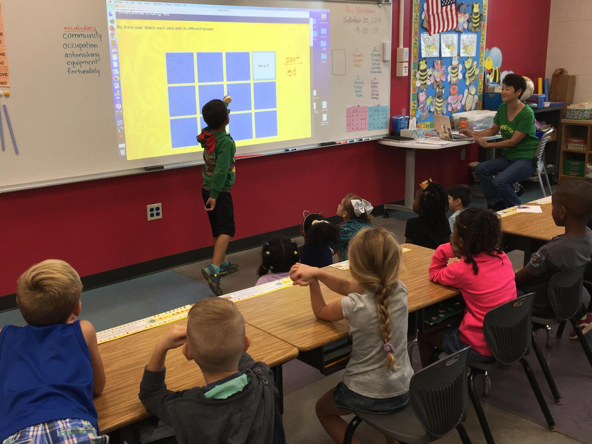 Student Using Laser Projector and Interactive Whiteboard