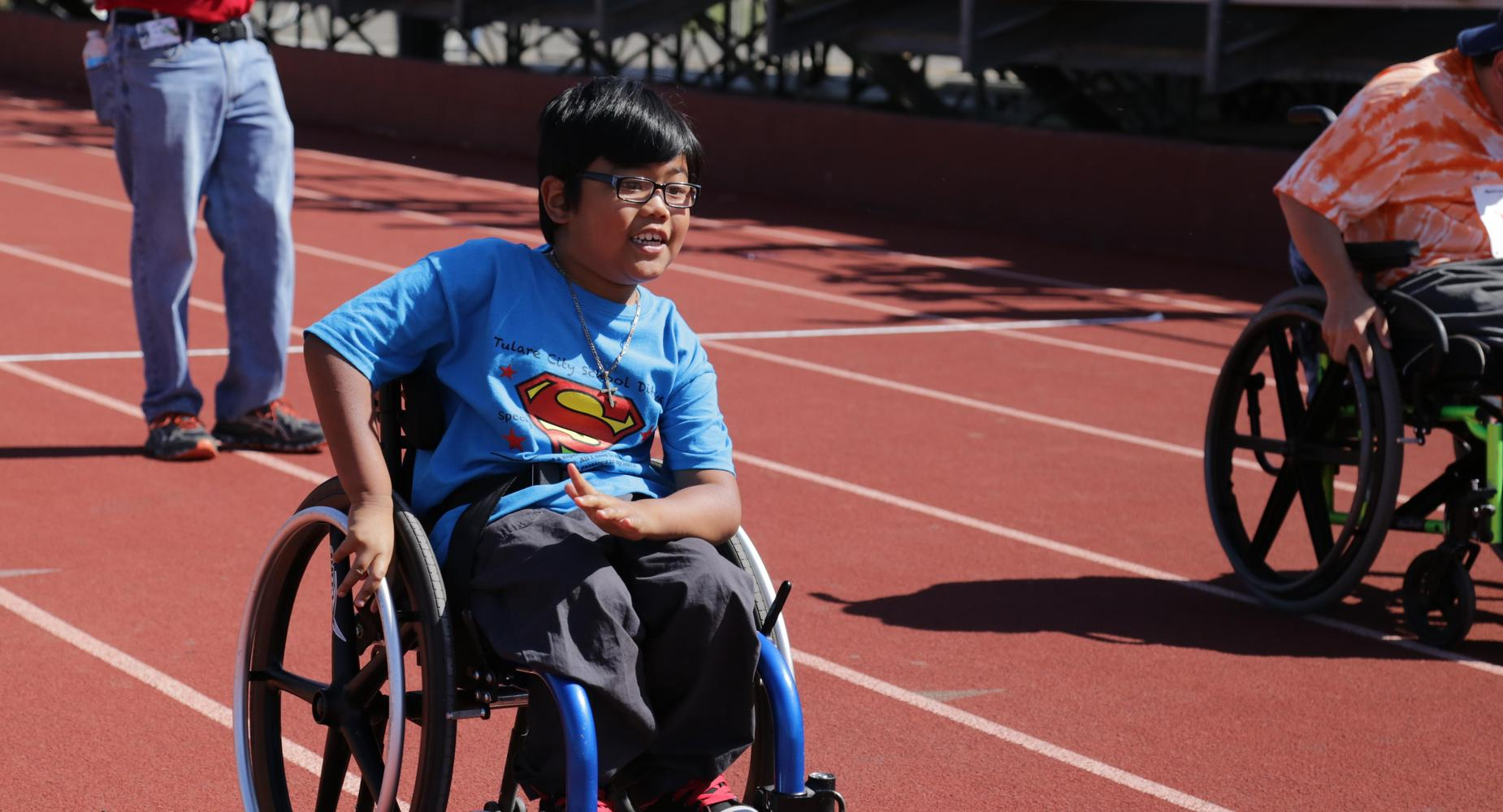 Student participating in wheelchair race