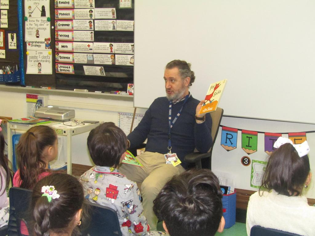 children listening to dr. williams reading them a dr. seuss story