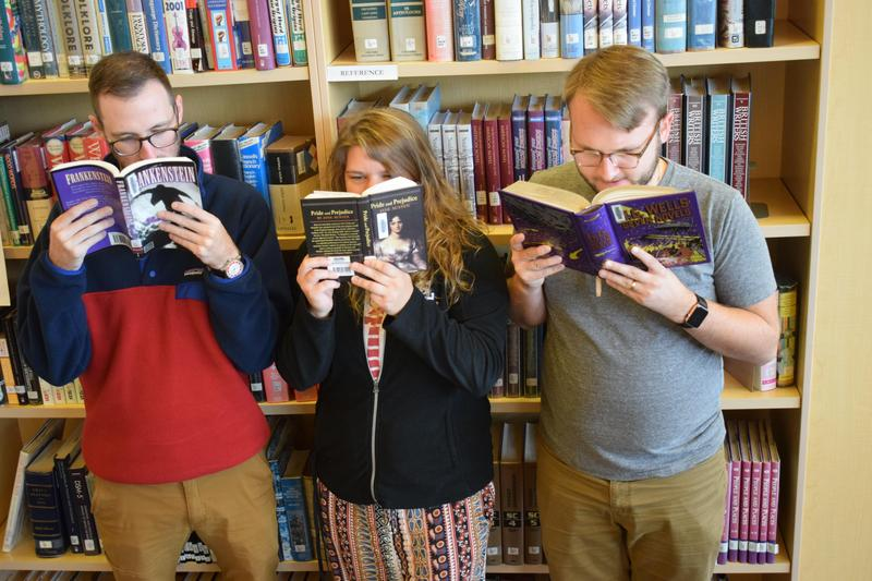 three people reading
